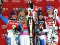 © ASP Red Bull - DH in Lake Louise: (From left to right) Stacey Cook (USA, 2nd), Lindsey Vonn (USA, 1st), Tina Weirather (LIE, 3rd) and Maria Höfl-Riesch (GER, 3rd).